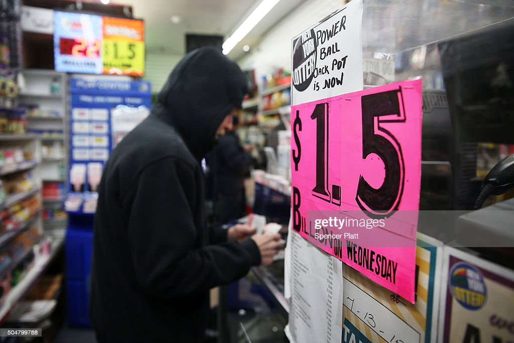 People purchase Powerball tickets at a magazine store on January 13, 2016 in New York City. After no winners were declared in recent drawings, Wednesday night's $1.5-billion jackpot is the biggest in lottery history. Powerball is played in 44 states and three U.S. territories.