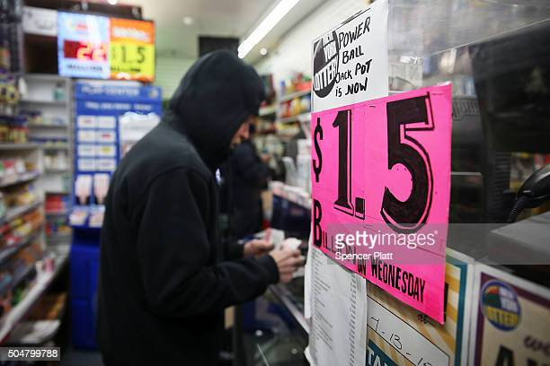 People purchase Powerball tickets at a magazine store on January 13 2016 in New York City After no winners were declared in recent drawings Wednesday...