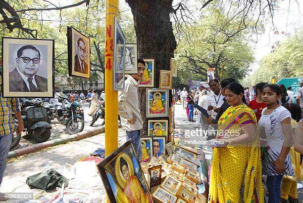 People purchasing portrait and statues of Dr BR Ambedkar after paying tributes on his birth anniversary at Parliament Street on April 14 2015 in New...