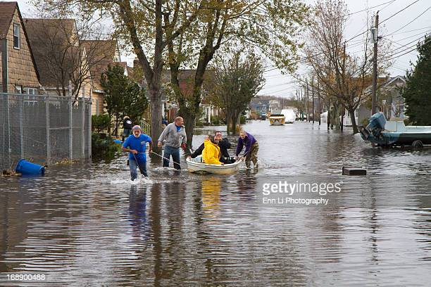 CONTENT] people pushing kayak on flooded street in Long IslandOctober 30 2012 in MassapequaLong islandNew York after Hurricane Sandy hit the East...
