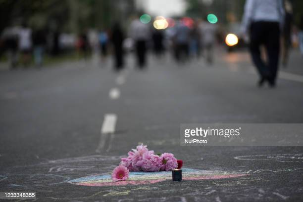 People put flowers and candles during a vigil to remember the four family members killed by a vehicle in a hate-motivated crime in London,Ontario-...