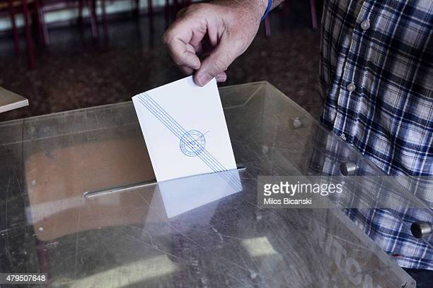 People put referendum votes in the ballot box at a school on July 5 2015 in Athens Greece The people of Greece are going to the polls to decide if...