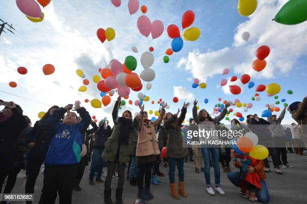 People put up baloons into the sky in rememberance of the tsunami victims during the third anniversary of the Great East Japan earthquake and tsunami...