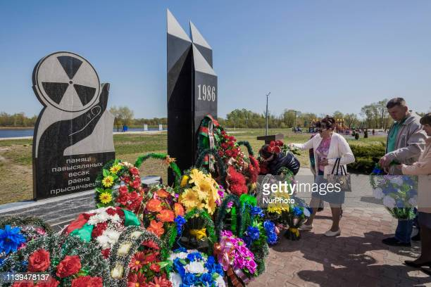 People put wreaths in the Chernobyl memorial of the catastrophe in Naroulia, Belarus. In 1986, the city experienced heavy radioactive fallout from...