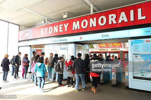 People qeue to purchase tickets to ride the Sydney monorail at Paddy's Market station on June 26 2013 in Sydney Australia The Sydney monorail will...