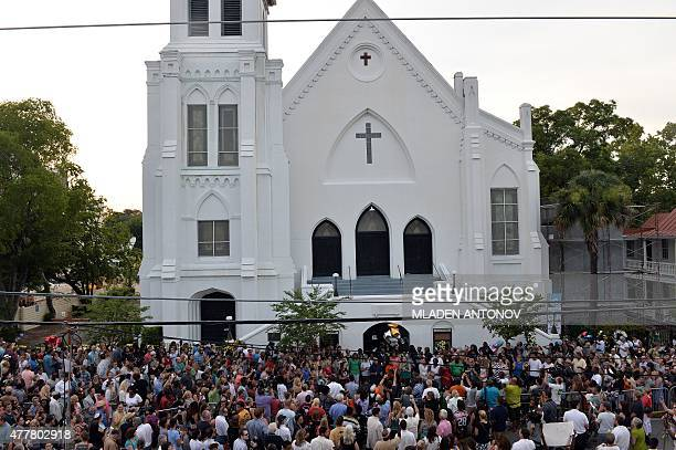 People que to lay flowers at Emanuel AME Church in Charleston, South Carolina on June 19, 2015. Police captured the white suspect in a gun massacre...
