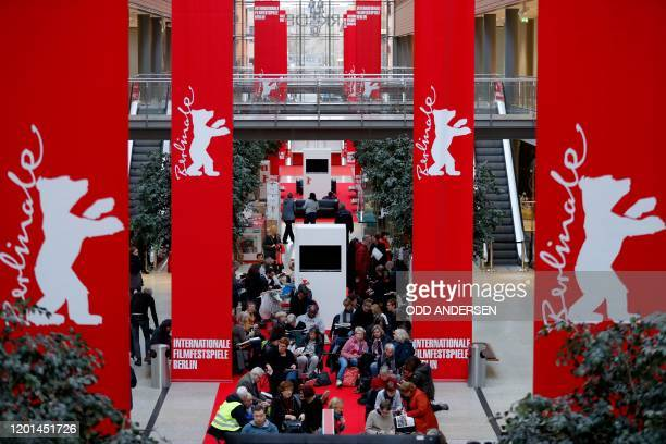 People queue as they wait for the 70th Berlinale film festival tickets to go on sale at the Potsdamer Arkaden mall in Berlin on February 17, 2020. -...
