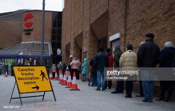 February 08: People queue as they wait to receive their first dose of Covid Vaccine in freezing temperatures on February 08, 2021 in Newport, Wales....
