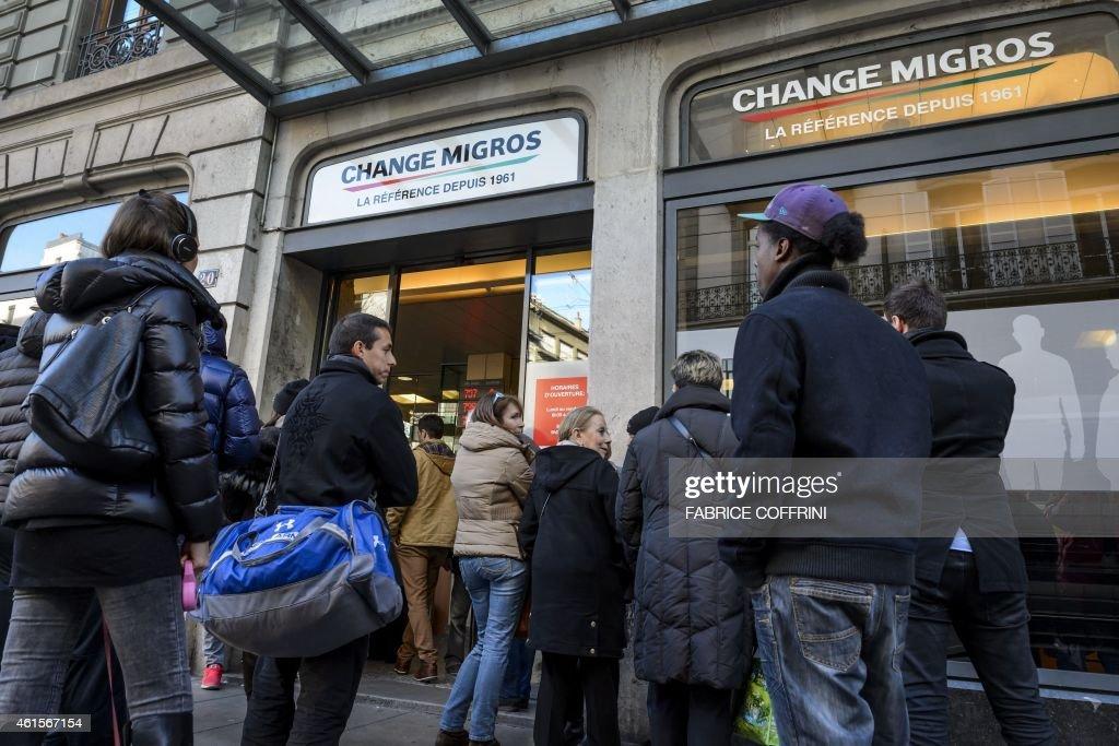 People queue at a bureau de change to buy euros in geneva on