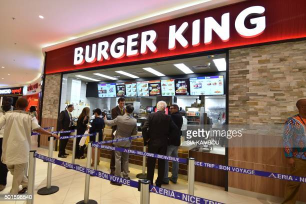 People queue at a Burger King fast food restaurant during the inauguration of the first Carrefour supermarket of SubSaharan Africa in Abidjan on...