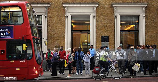 People queue at a bus stop at London Bridge station in London on September 6 2010 Unions are set to strike tonight for 24 hours bringing parts of...