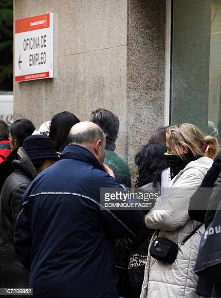 People queue at a government employment office in centre of Madrid on November 30, 2010. Spain's fledging economic recovery came to a stop in the...