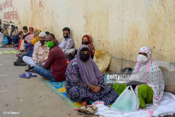 People queue at a hospital for COVID-19 swab tests during the coronavirus crisis. Bangabandhu Sheikh Mujib Medical University is being used to...