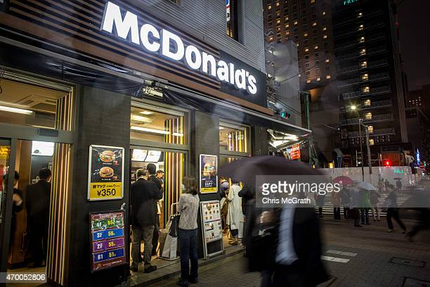 People queue at a McDonalds restaurant on April 17 in Tokyo Japan McDonald's Holdings Co announced on April 16 2015 that it expects to post a 38...