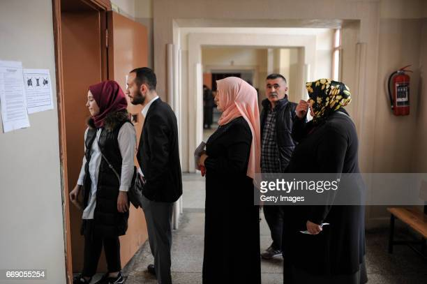 People queue at a polling station during a referendum in Istanbul April 16 2017 Turkey Millions of Turks are heading to the polls to vote on a set of...