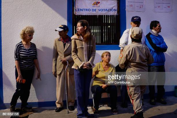 People queue at a polling station in San Cristobal in Tachira State during regional elections in Venezuela on October 15 2017 Venezuelans headed to...