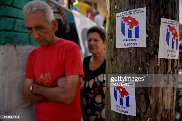 People queue at a polling station in Santa Clara Cuba during an election to ratify a new National Assembly on March 11 2018 Cubans vote to ratify a...