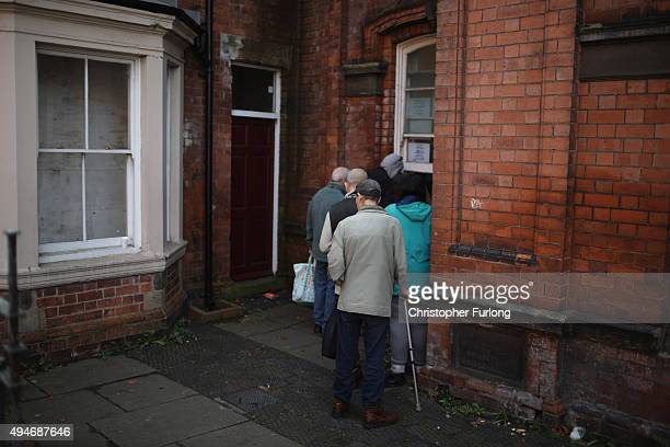 People queue at a soup kitchen in Wolverhampton which has been declared the most miserable place in Britain on October 28 2015 in Wolverhampton...