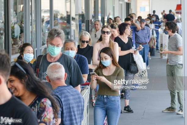People queue at a supermarket after the South Australian state government announced a six-day lockdown because of a Covid-19 coronavirus outbreak in...