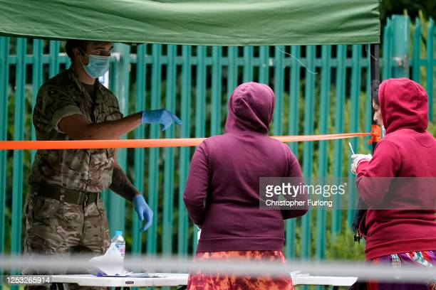 People queue at a walk-in coronavirus testing centre at Spinney Park on June 29, 2020 in Leicester, England. In a television appearance on Sunday,...