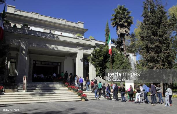 People queue at Los Pinos presidential residence in Mexico City, on December 2, 2018 after Mexico's newly inaugurated president Andres Manuel Lopez...
