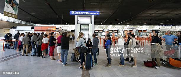 People queue at Nice's airport southeastern France on April 9 2015 during an air traffic controllers twoday strike over working conditions Hundreds...