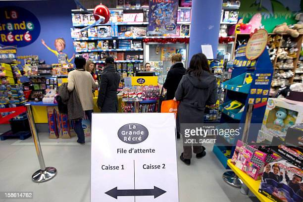 People queue at the cash desk of a toy store on December 21 2012 at the KremlinBicetre outside Paris AFP PHOTO / JOEL SAGET