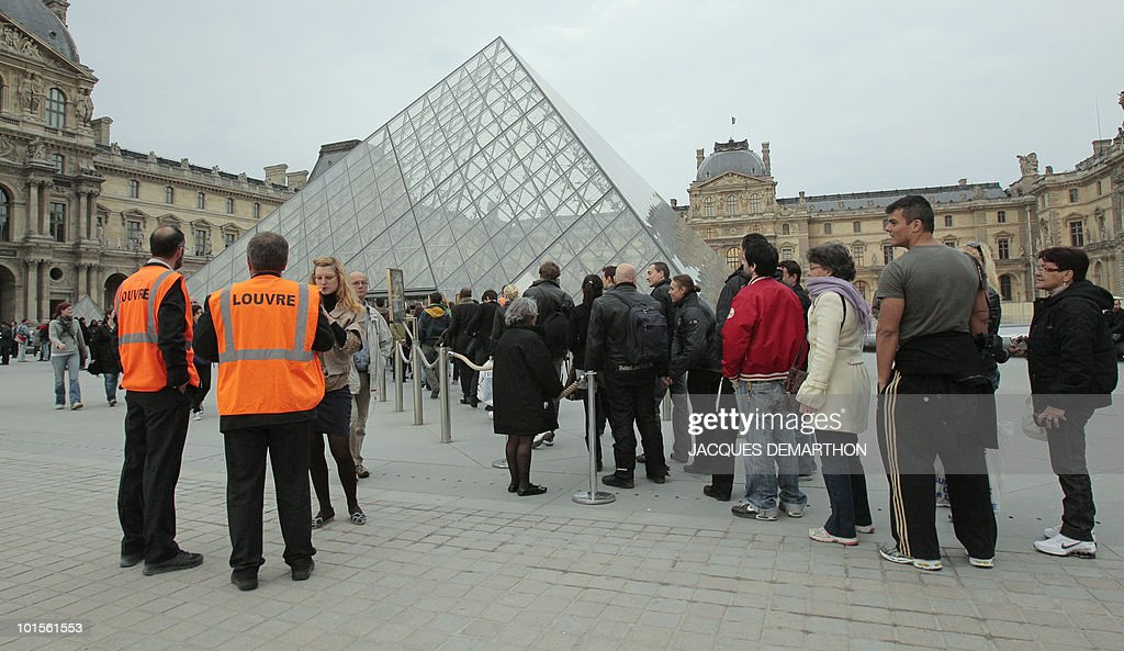 People queue at the entrance of the Louvre Museum during the 6th edition of the 'Nuit des musees' (Museum night) yearly event on May 15, 2010 in Paris. During this cultural event, various museums in France and in Europe will remain open late night and let free access to visitors.