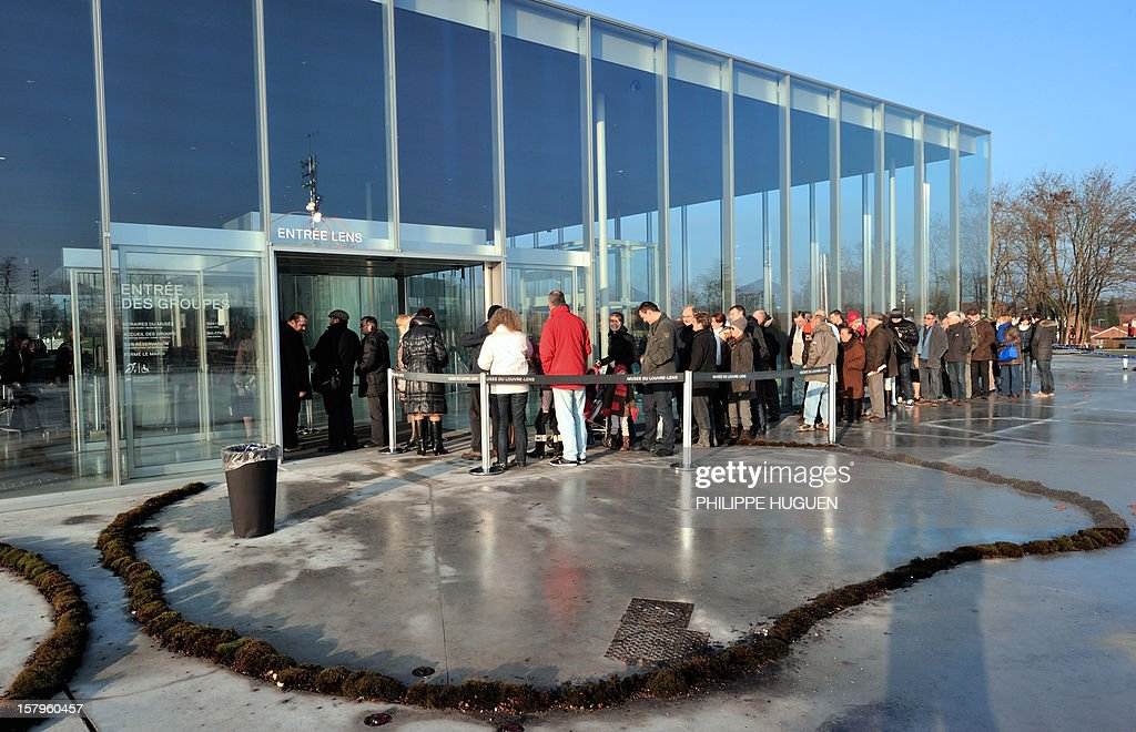 People queue at the entrance of the Louvre-Lens museum on December 8, 2012 in Lens, northern France. The Louvre museum opened a new satellite branch among the slag heaps of a former mining town on Dcember 4, 2012 in a bid to bring high culture and visitors to one of France's poorest areas.