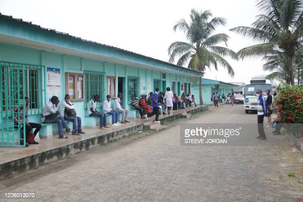 People queue at the Nkembo health centre in Libreville on July 9, 2020 to get tested for the COVID-19 coronavirus.