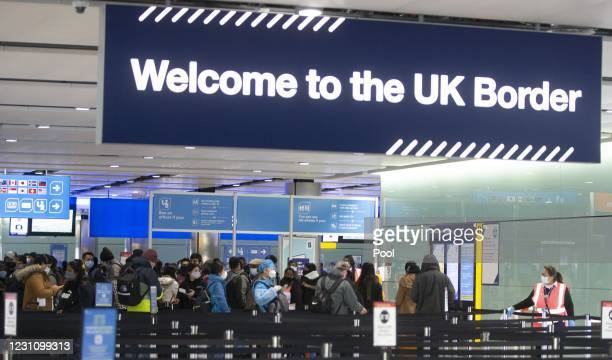 People queue at UK border control at Terminal 2 at Heathrow Airport on February 11, 2021 in London, England.