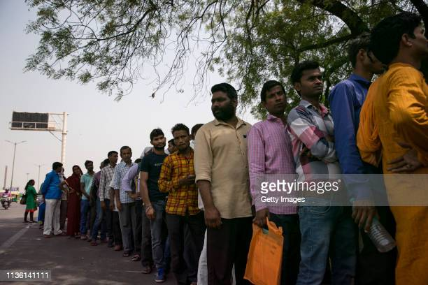 People queue for a 5 rupee meal giveaway outside a hospital on April 6 2019 in New Delhi India With a rising number of jobless youths unemployment...
