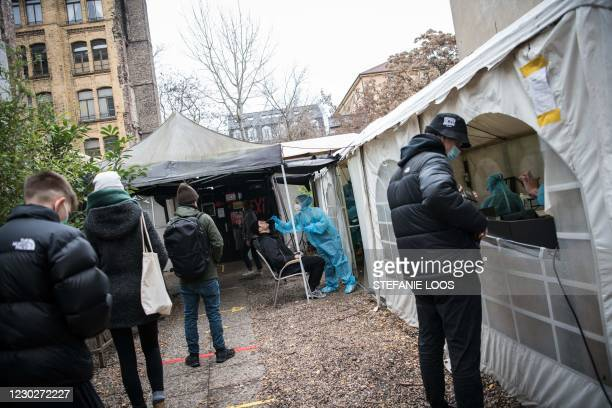 People queue for a swab to test for the Covid-19 coronavirusoutside the Berlin KitKatClub night club turned into a coronavirus test centre, on...