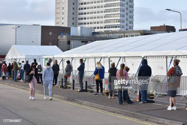 People queue for a test at a walk in Covid19 testing facility on September 17 2020 in Southend on Sea England The Department Of Health has appealed...