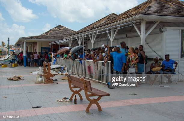 People queue for a water distribution on September 15 2017 in Marigot on the French Caribbean island of Saint Martin after the island was hit by...