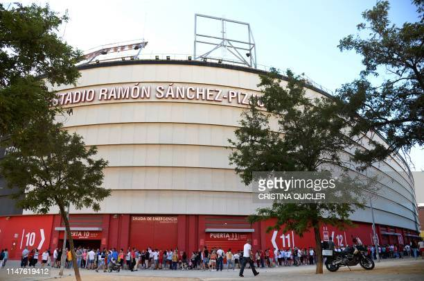 People queue for attending the wake for Spanish football player Jose Antonio Reyes at the Ramon Sanchez Pizjuan stadium in Seville on June 2 2019...