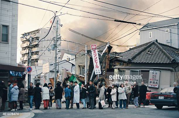 People queue for calling to their family members and relatives after the strong earthquake on January 17 1995 in Kobe Hyogo Japan Magnitude 73 strong...