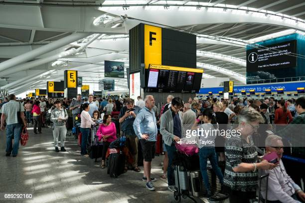 People queue for checkin at Heathrow Airport Terminal 5 on May 28 2017 in London England Thousands of passengers face a second day of travel...