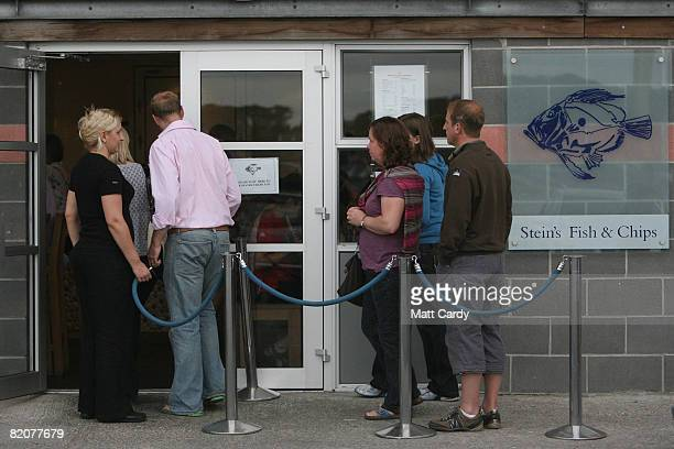 People queue for fish and chips at Rick Stein's at the harbourside on July 26 2008 in Padstow England David Cameron leader of the opposition who's...