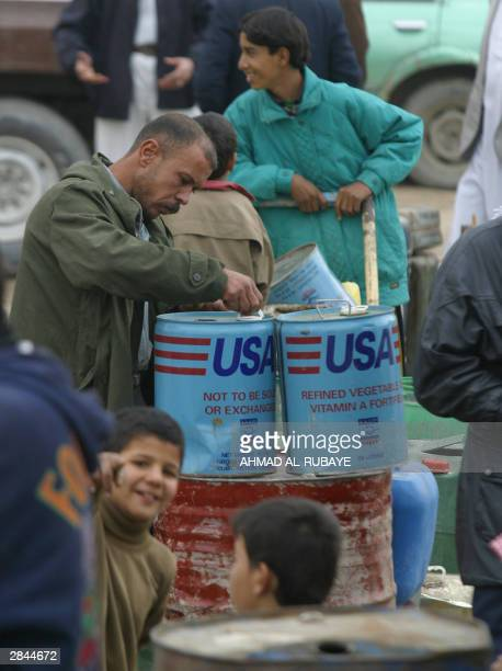 People queue for heating fuel in Baghdad's central Rusafa district 05 January 2004 Iraq's top Shiite Muslim leaders have called on Iraqi officials to...