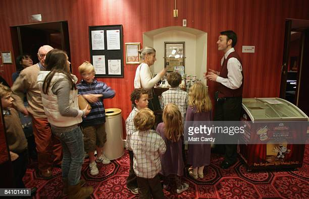 People queue for ice creams during the interval for the traditional pantomime Jack and the Beanstalk at the Theatre Royal Bath on December 20 2008 in...