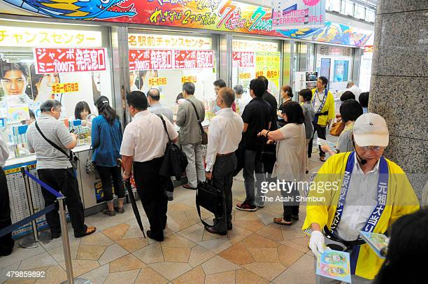 People queue for purchasing lottery tickets of the 'Summer Jumbo Lottery' at Nagoya Station on July 8 2015 in Nagoya Aichi Japan The lottery which...