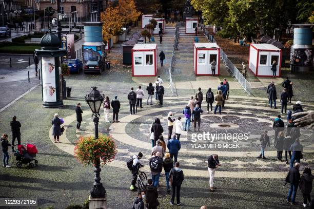 People queue for test for the novel coronavirus COVID-19 during nationwide testing in Bratislava, Slovakia on October 31, 2020. - Slovakia on october...