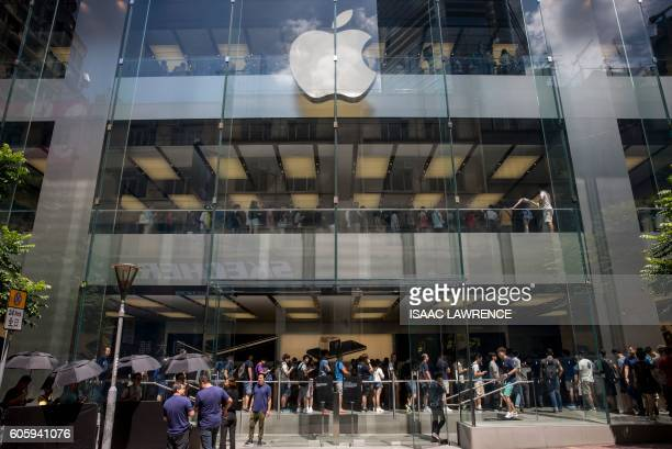 People queue for the new iPhone 7 during the opening day of sales at an Apple store in Hong Kong on September 16 2016 With new iPhones hitting the...
