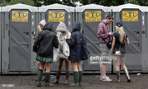 People queue for toilets during the second day of the annual rock and pop 'V Festival' at Hylands Park Chelmsford on August 19 2007 in Essex England...