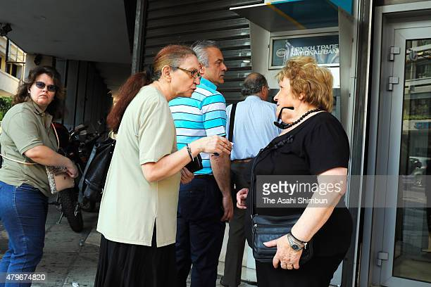 People queue for withdrawing cash at ATM a day after EU proposal was rejected on July 6 2015 in Athens Greece The greek people have rejected a debt...