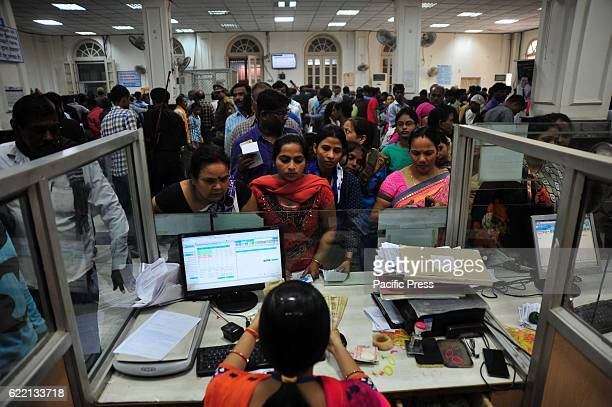 People queue in a bank to exchange their 500 and 1000 currency after Prime minister Demonetized currency of 500 & 1000 in Allahabad.