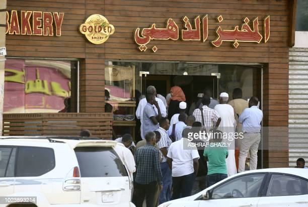 People queue in front of a bakery in the Sudanese capital Khartoum on August 26 2018 The Sudanese capital is experiencing a shortage of bread forcing...