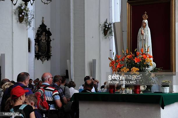 People queue in front of a Virgin inside the old gothic Marien church on June 12 in Gdansk Poland and Ukraine cohost the Euro 2012 football...