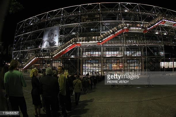 People queue in front of the entrance of famous Georges Pompidou center to attend the 7th edition of the Museums European Night, on May 14, 2011 in...